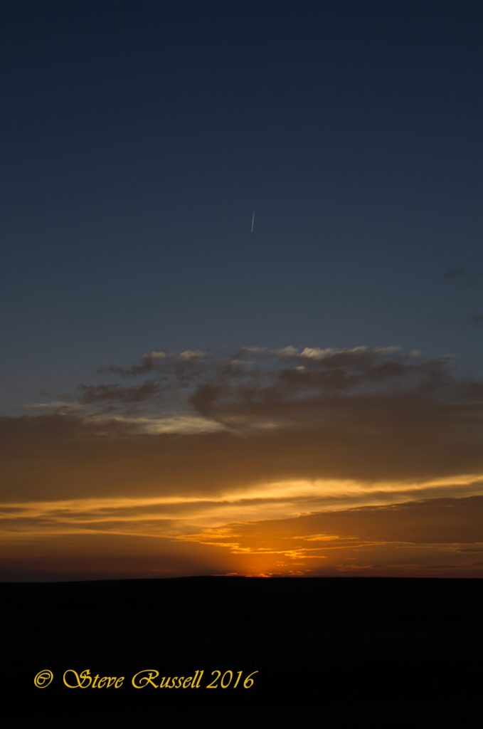 Meteorite flashing across the evening sky at sunset.